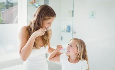 mother & daughter brushing teeth together