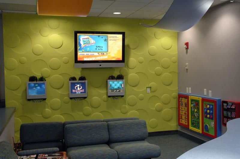 Woodbury pediatric interior shot of a waiting room with seating and tvs