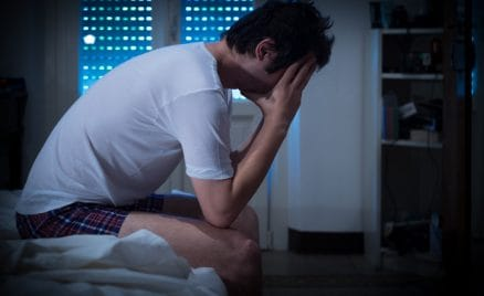 man is stressed out from lack of sleep