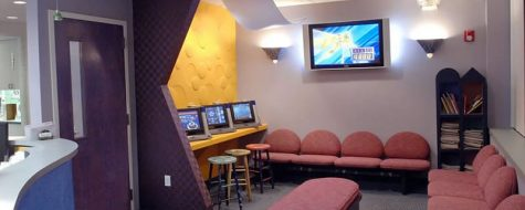 Woodbury Pediatric interior shot of a waiting room with a TV and seating