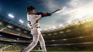 New York Yankees baseball player hitting baseball