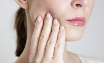 woman has jaw pain