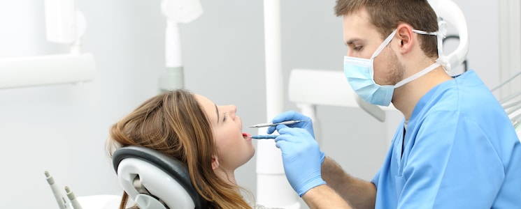 Dentist working with a patient
