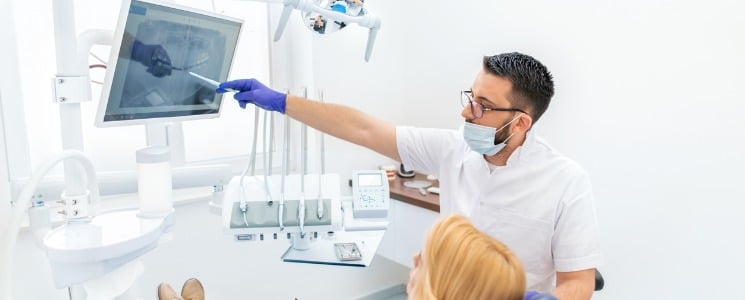 Dentist explaining xrays to patient | Dentist New York