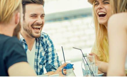 Friends Smiling together having drinks