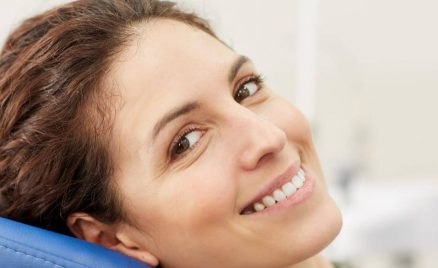 Woman in the dentists office smiling